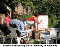 IlseMarie-leads-staff-meeting